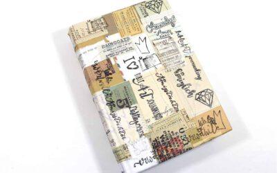 Bibeleinband mit der Nähmaschine und Papier